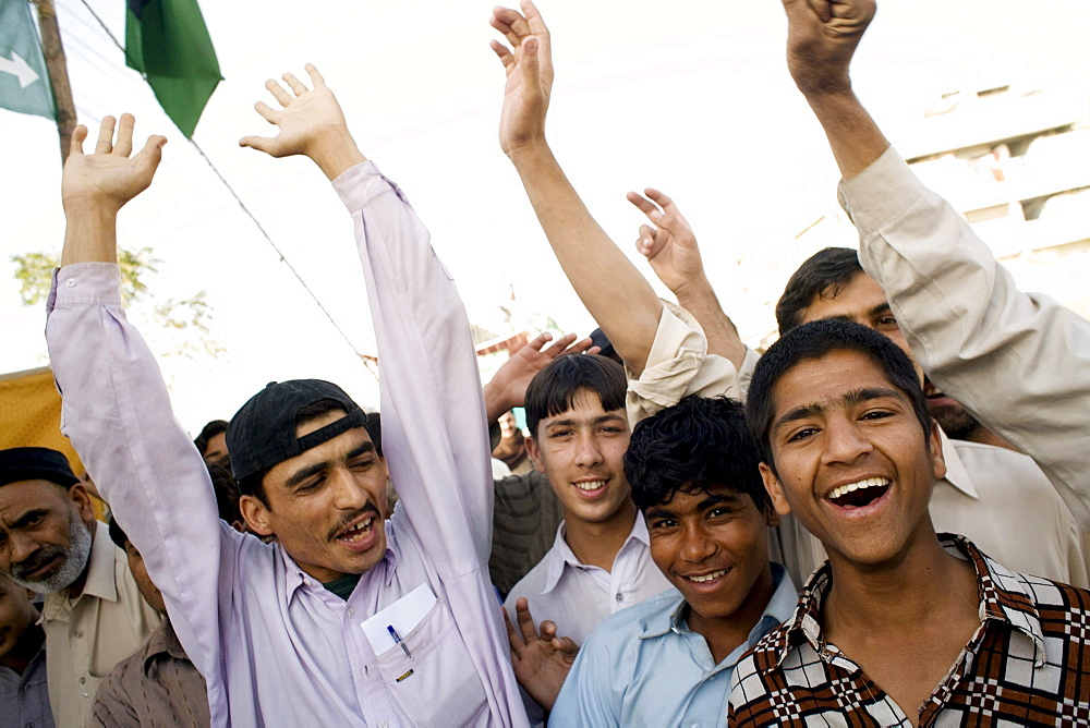 Pakistanis stage an informal rally in support of the PPP on election day in Karachi, Pakistan  on February 18, 2008.