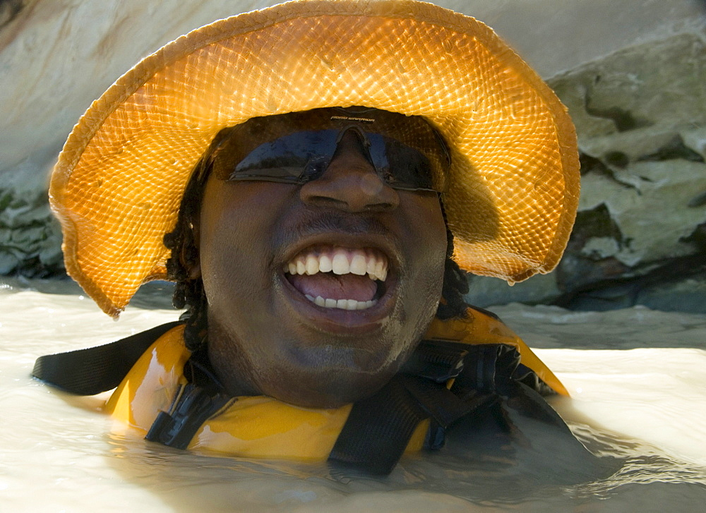A boy floats down the Dolores River while on a rafting outing in Mexican Hat, Utah, United States.