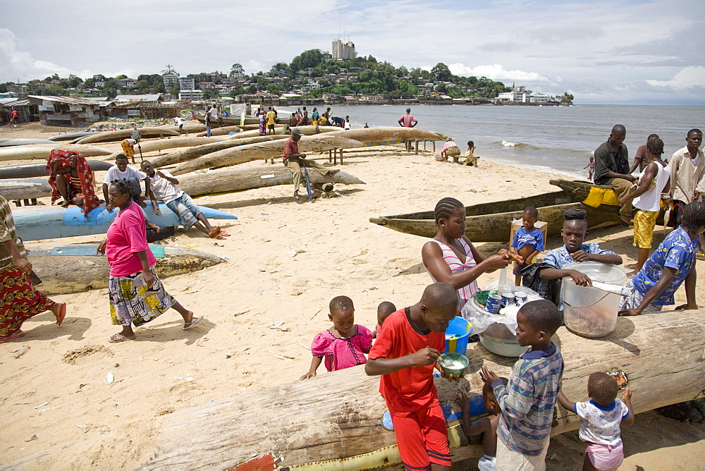 Monrovia, Liberia - September 19, 2007: Children selling snack food on the beach in the the fishing community of West Point in the Liberian capital of Monrovia which is one of the poorest slums in West Africa and suffers from overcrowding, lack of facilities, unemployment  and garbage. The fishing industry is an important source of employment and food for Liberians and is increasingly under threat by better equipped and unregulated foreign vessels over fishing in its unprotected waters.