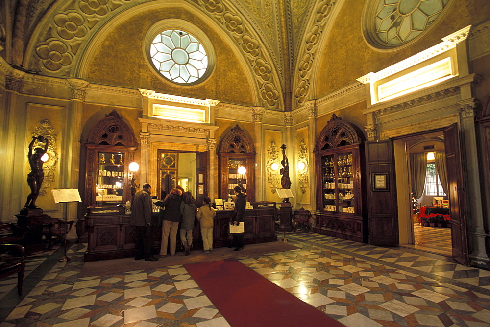 The main sales room of the Santa Maria Novella pharmacy in Florence, Italy. Established 600 years ago by Florentine monks, Santa Maria Novella is today a trendy purveyor of perfumes, soaps and elixirs.