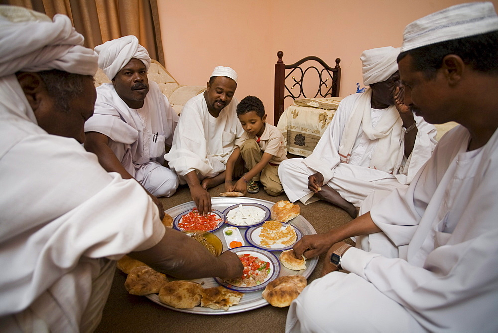Sayyid Abdelbagi at home in El Obeid, Sudan (fourth from right) celebrating the purchase of camels that will go to Egypt.