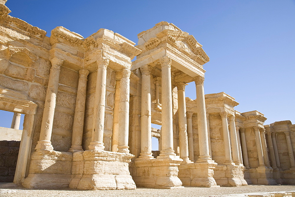 Palmyra, Syria - January, 2008: Roman ruins in the desert.  Palmyra or Tadmore was a 2nd century AD desert oasis used as a strategic staging post for caravans traveling between the Mediterranean Sea and the east.  It was also settled by the Assyrians, and Persians.