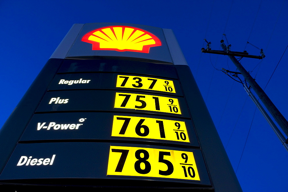 Low angle view of a Shell gas station sign depicting 7 dollar a gallon gas near Burns, Oregon.