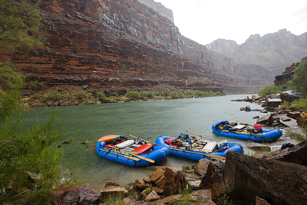 A sudden rain storm catches rafters on the Colorado River at the Grand Canyon in Arizona.