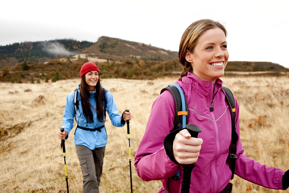 Two females smile while day hiking in the Columbia Gorge, Oregon.