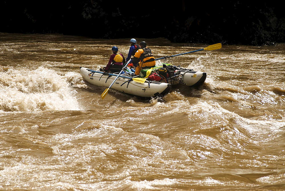 Rubber rafts row downstream during a whitewater rafting trip in Western China.