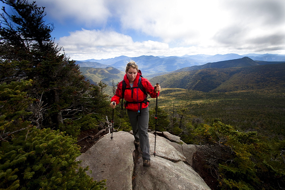 An athletic female hikes the Franconia Ridge Trail.