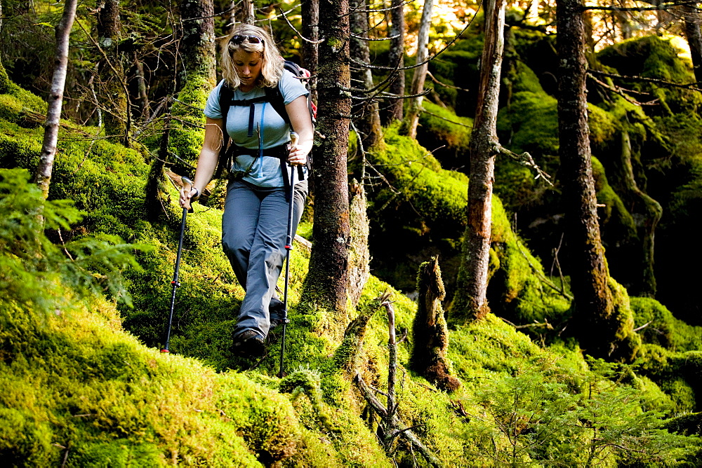 An athletic female hiker hikes the Franconia Ridge Trail.