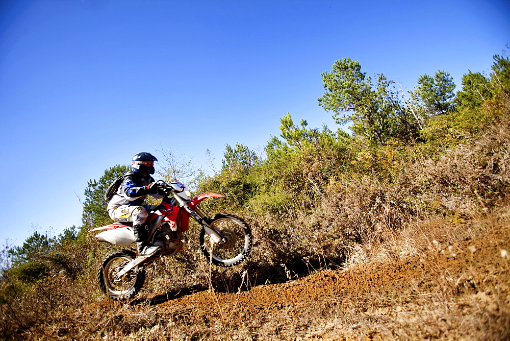 A motorcyclist rides through the brush in an Enduro race in Maplesville, Alabama. (Motion Blur)