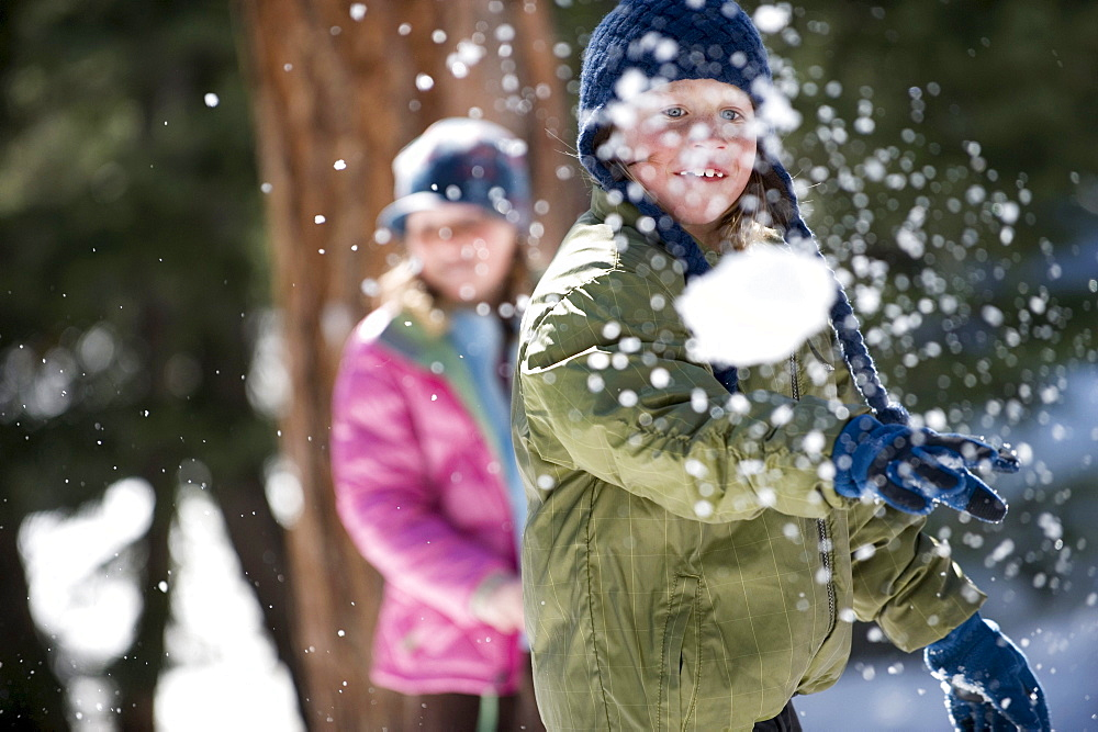 A boy and girl enjoy a snowball fight in Lake Tahoe, California. - 857-79839