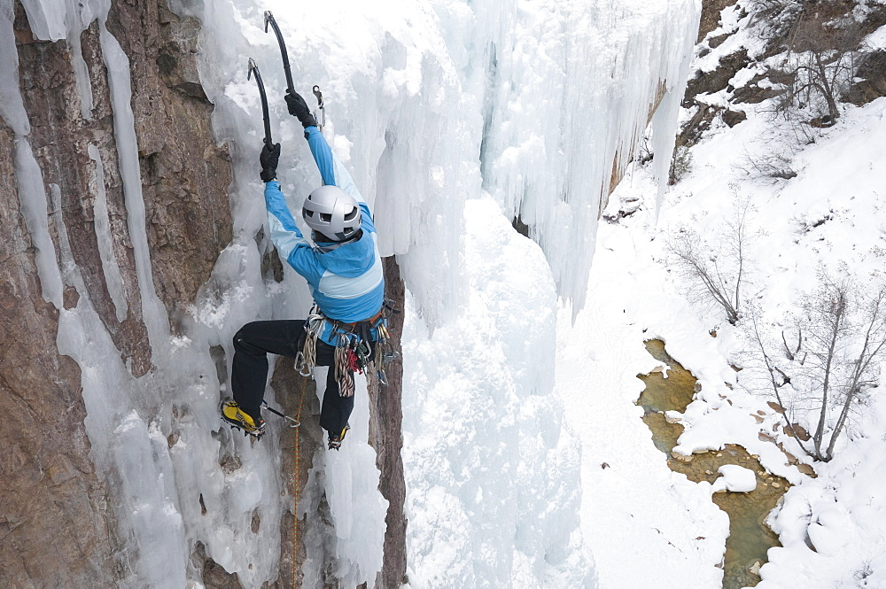 Woman ice and rock climbing, Ouray, Colorado.