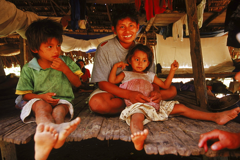 A Machiginga Indian family at their home at a remote encampment on the Rio Azul, a rarely traveled river in the Peruvian Amazon.