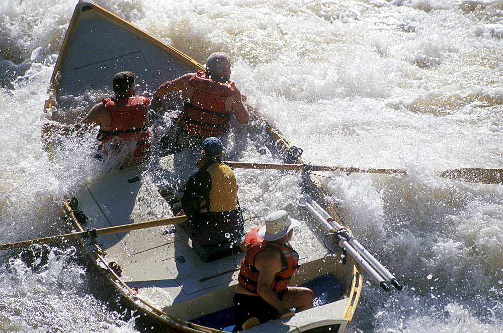 A wooden dory is tossed in the whitewater of 24-Mile Rapid on the Colorado River in Grand Canyon National Park, Arizona.