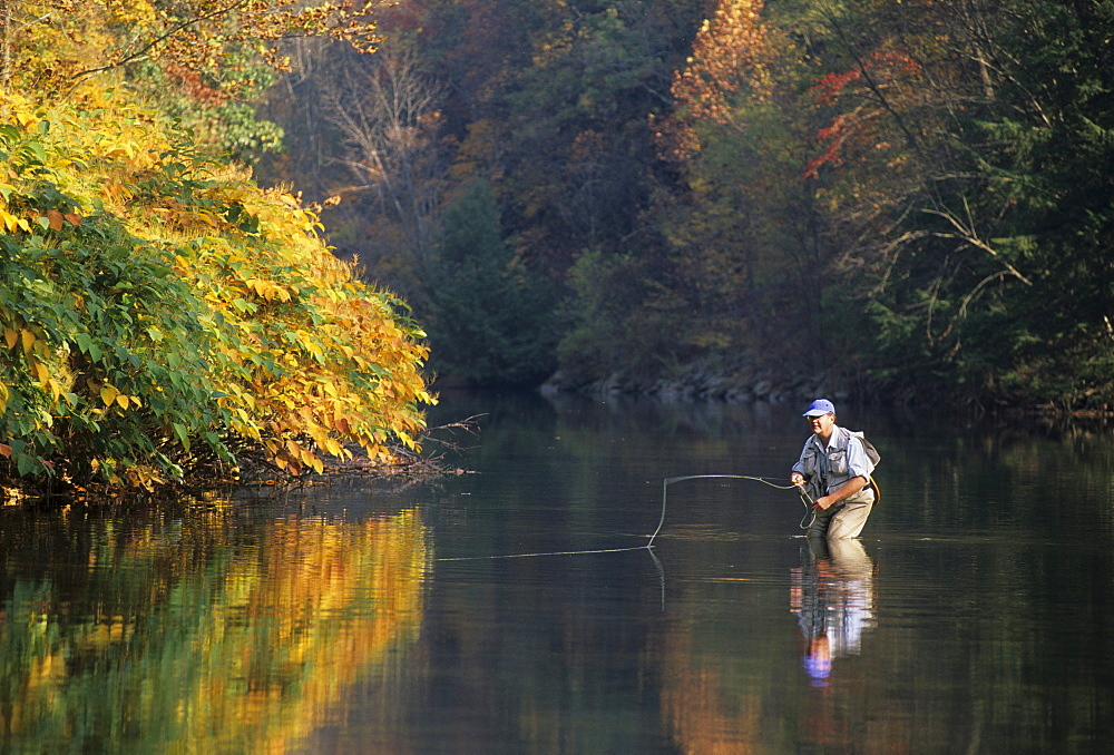 A person fly fishing in Pennsylvania.