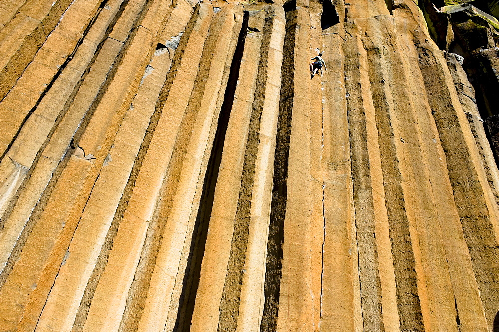 A mid adult man rock climbing at Trout Creek, Oregon.