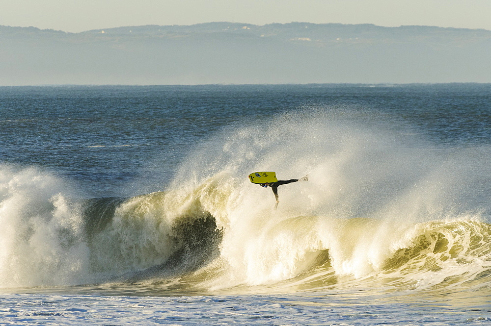 Bodyboarder flies high at sunrise in Nazare Special Edition contest held in Nazare, Portugal.