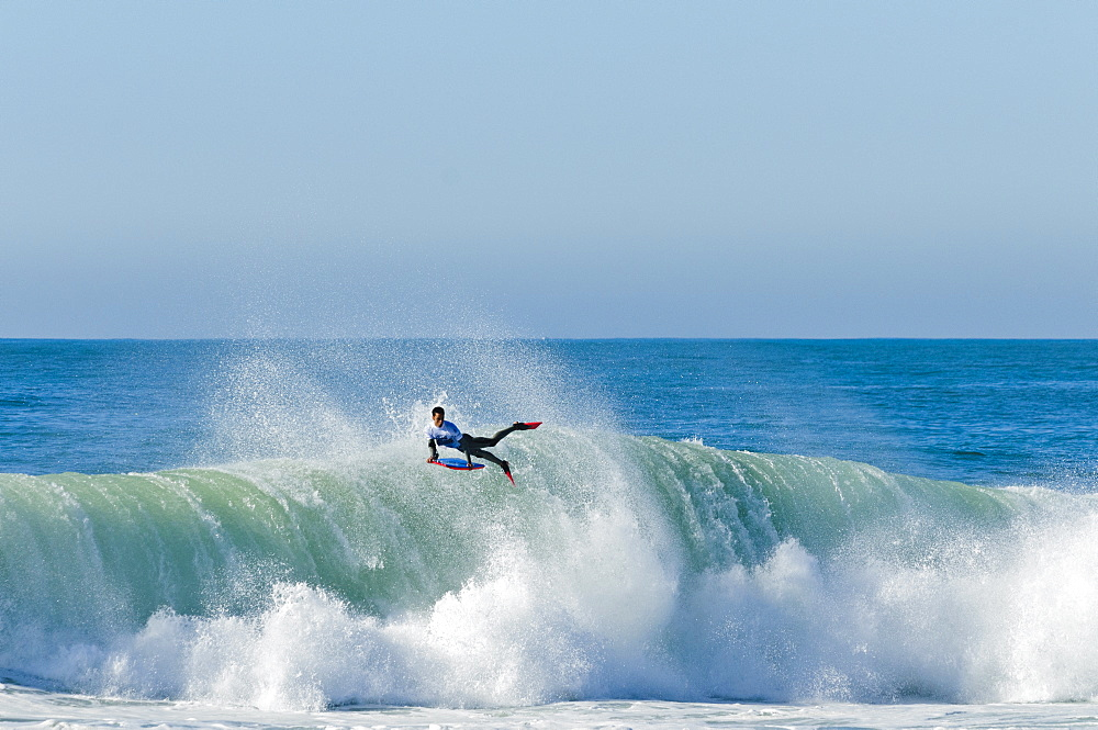 Bodyboarder landing an air reverse at Nazare Special Edition, help in Portugal.