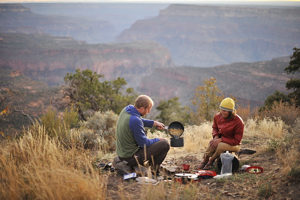 Campers prepare dinner on the North Rim of the Grand Canyon before a hike down into the ditch outside of Fredonia, Arizona November 2011.