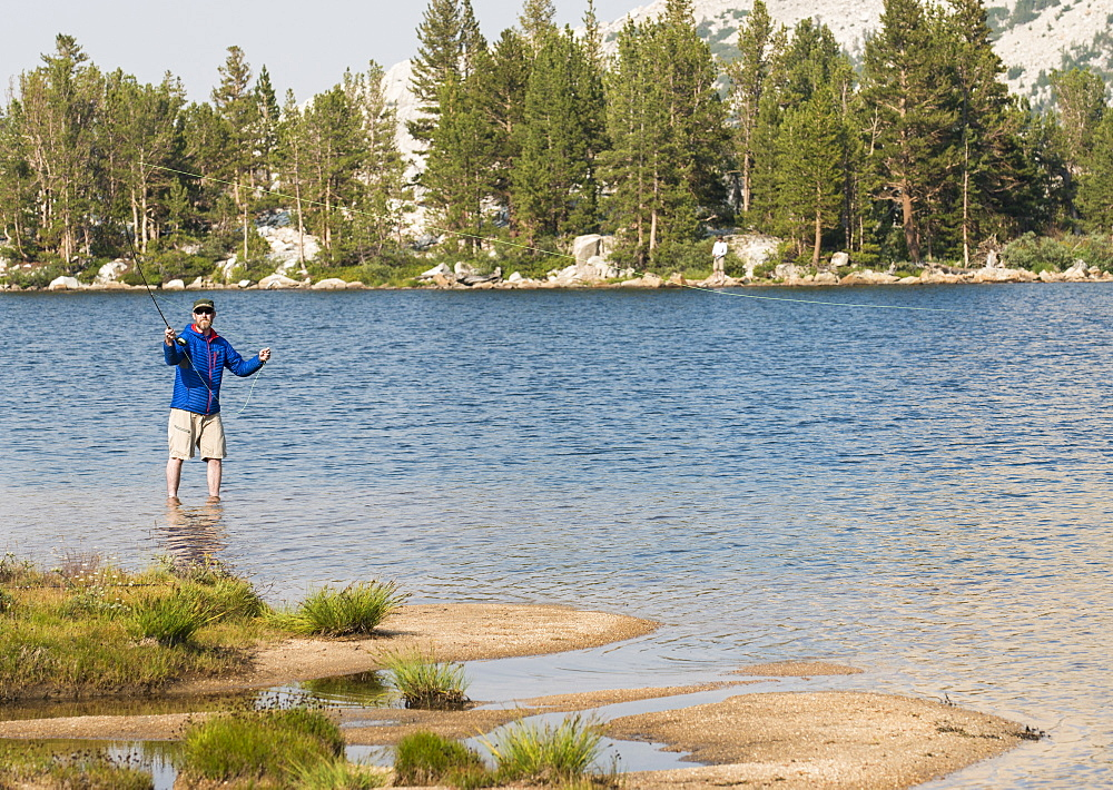 A man tries his hand at a little early morning fly fishing in the High Sierra, California