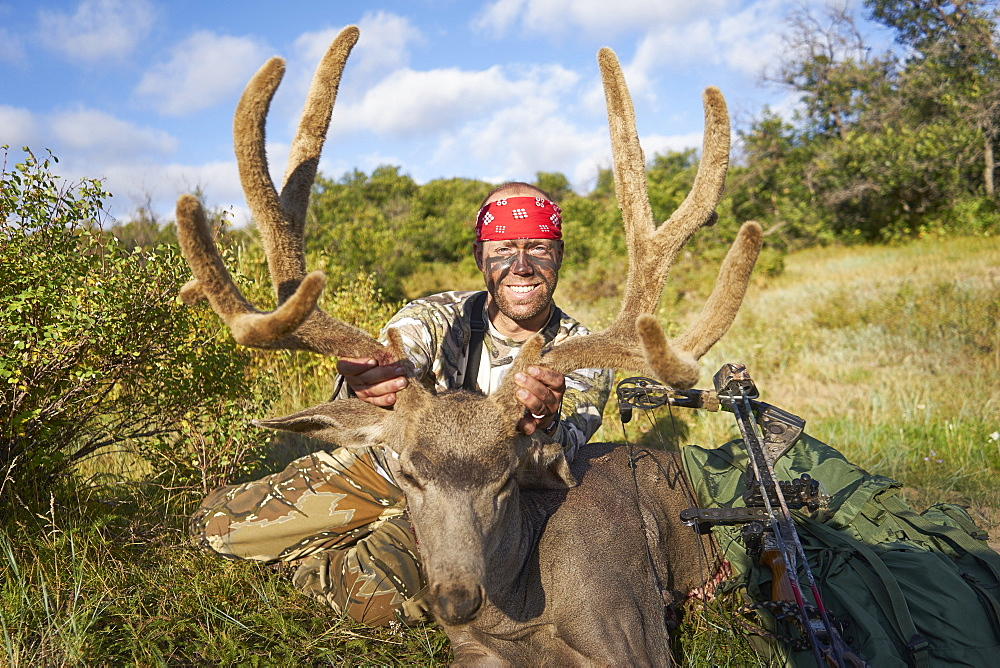 Bow Hunter with red bandana poseing with his trophy, Pagosa Springs, CO, USA