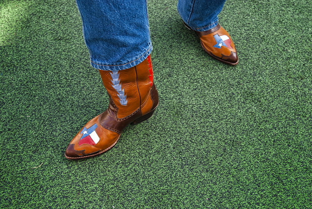 A Texan displays his pride of the lone star state with his custom cowboy boots, Dallas, Texas, USA
