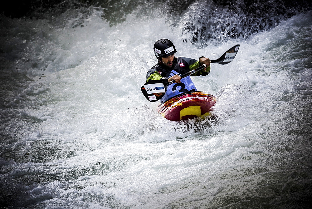Kayaker Hannes Aigner (GER) is riding the Ötztaler Ache-River during the Adidas Sickline Extreme Kayaking World Championship 2014 in Oetz, Austria.