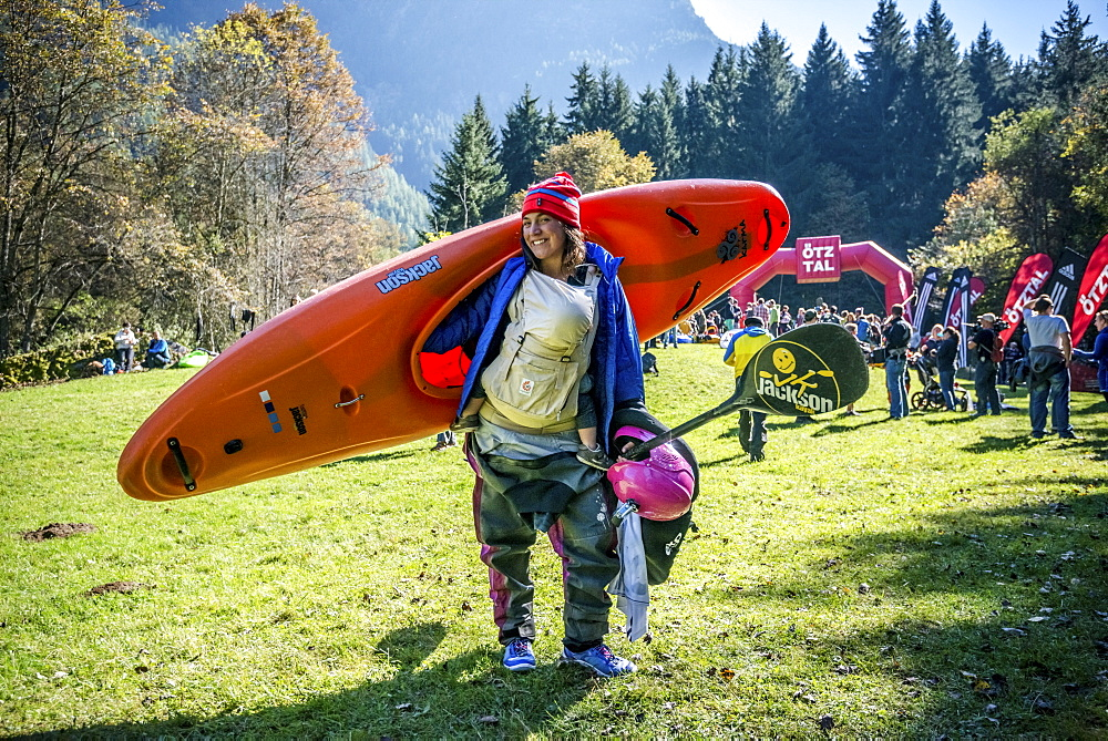 Kayaker Emily Jackson (USA) carrying a baby and a kayak at the Adidas Sickline Extreme Kayaking World Championship 2014 in Oetz, Austria.