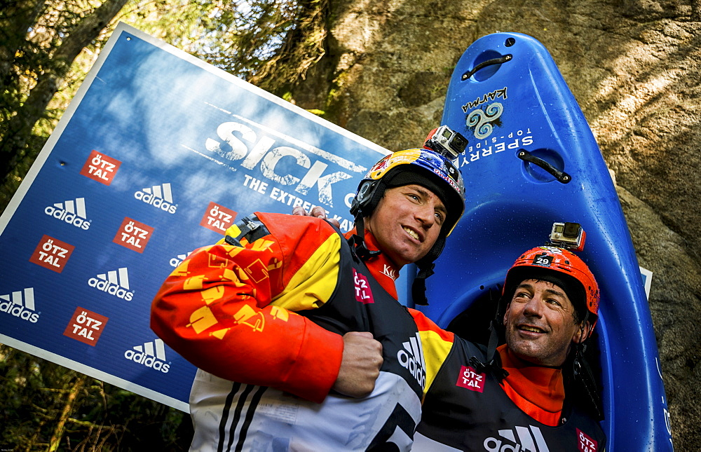 Red Bull sponsored kayaker Dane Jackson (USA, L) and his father Eric Jackson (R) giving Interviews during the Adidas Sickline Extreme Kayaking World Championship 2014 in Oetz, Austria.
