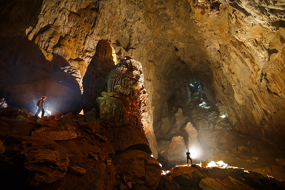 Cave explorers make their way to the exit of Hang Son Doong.