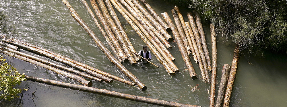 A ganchero was a person dedicated to a craft of assisting in the transport of a large quantity of loose logs floating downstream. by the river Tagus.