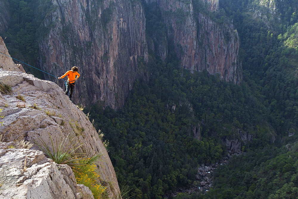 A man checks out the climbing routes at the top of Basaseachic waterfalls in Chihuahua, Mexico