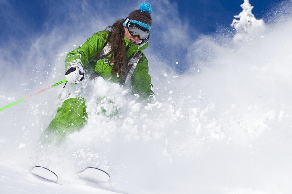 Jenn Berg skiing deep powder at Alta, Utah