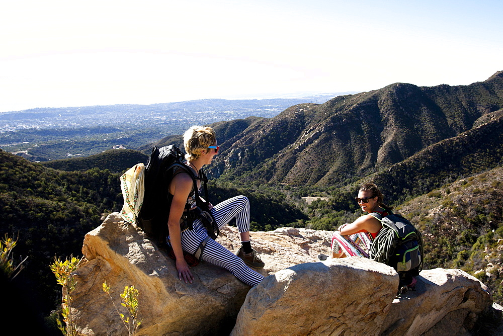 Two female climbers talk after climbing on Lower Gibraltar Rock in Santa Barbara, California
