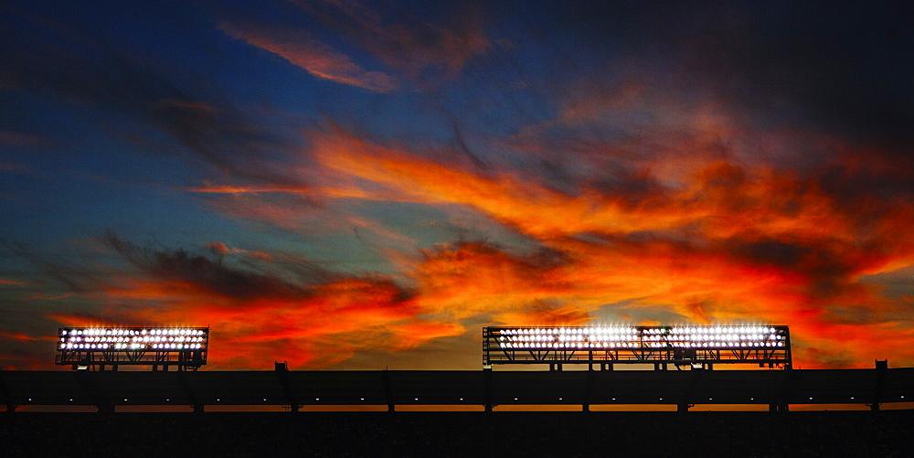 Stadium lights at sunset at the Angel Stadium of Anaheim, California. USA.