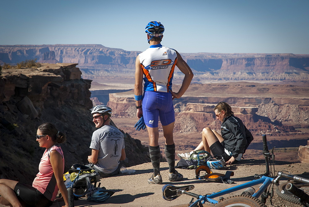 Friends explore the Utah desert in autumn with an extended mountain biking adventure on the White Rim Trail, Canyonlands National Park near Moab, Utah.