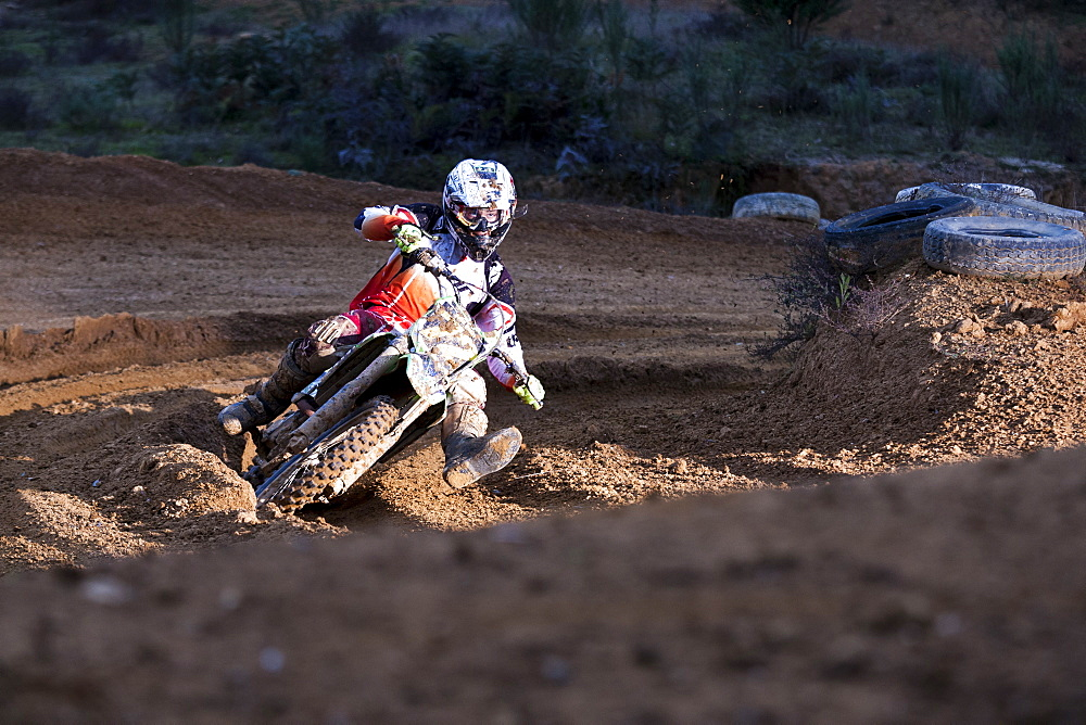 Motocross racer turns through a rutted corner while racing at Blackwood park.