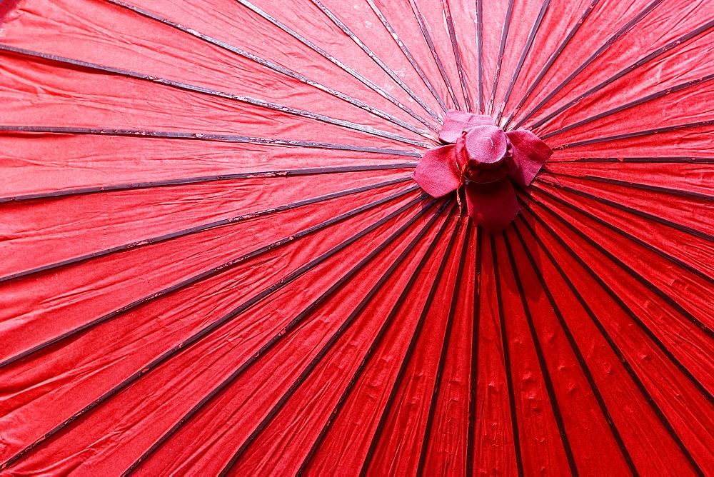 Top view close up of red paper umbrella, Japan.