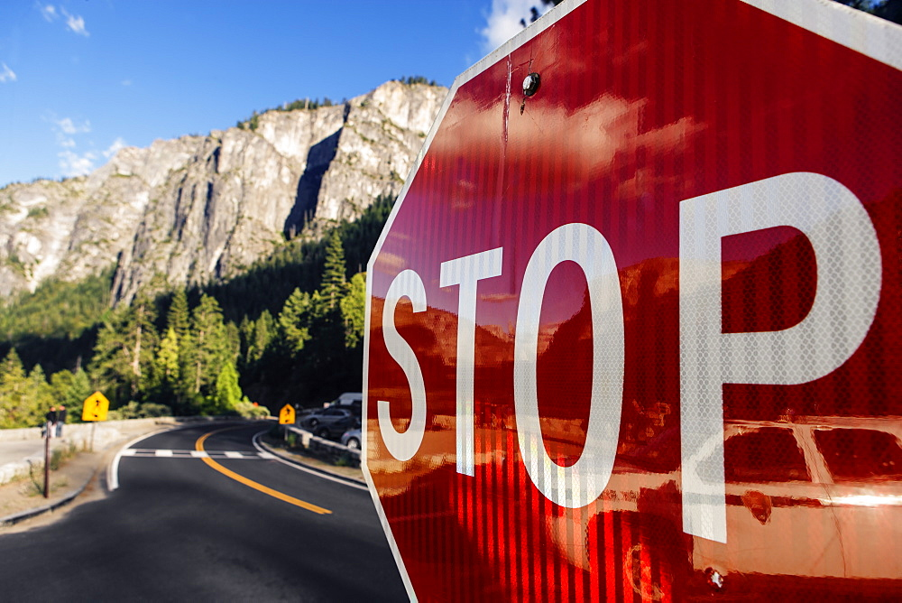 Close up of a red stop sign in Yosemite National Park in California, USA.