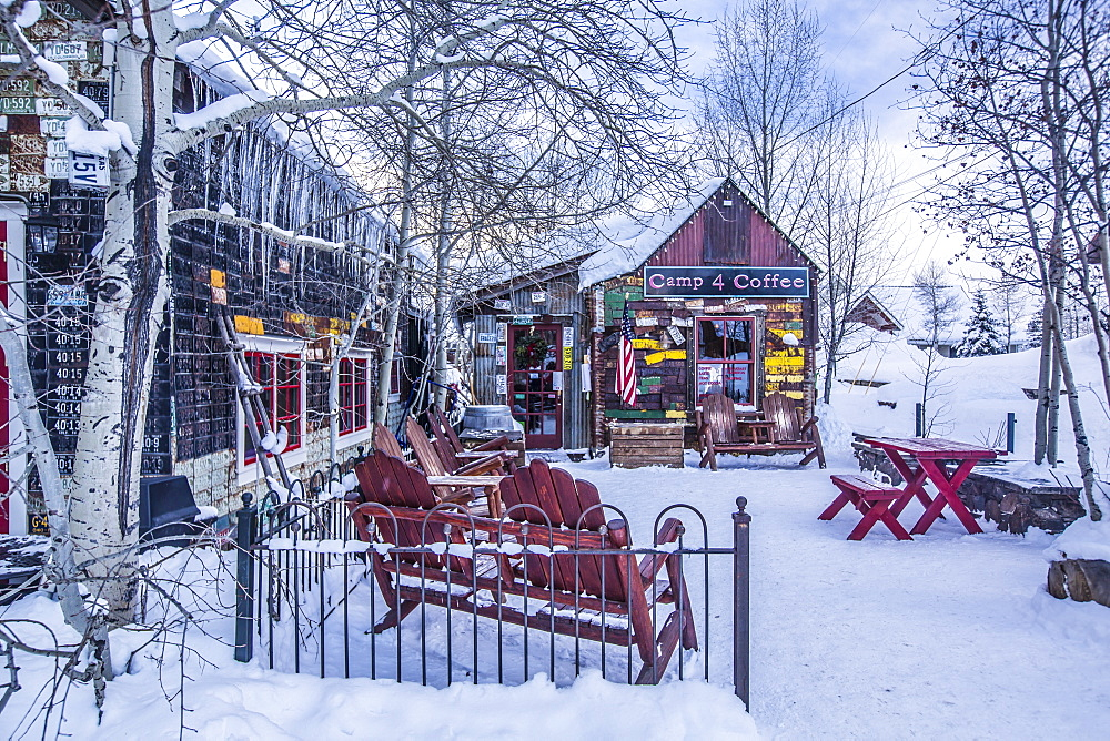A snow covered coffee shop, Camp 4 Coffee, in the town of Crested Butte, Colorado.