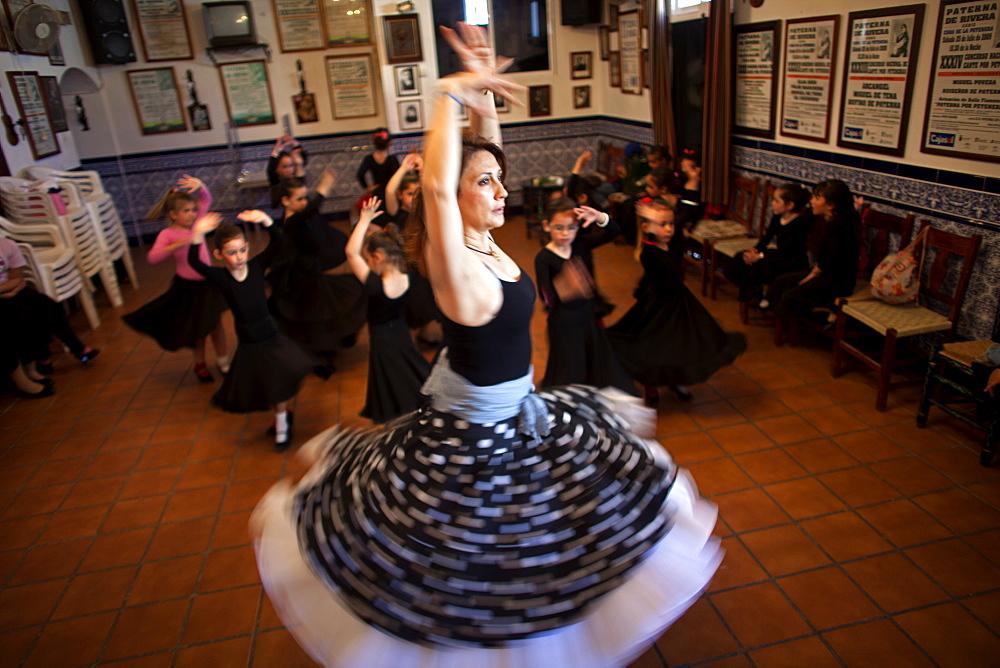 Olga Nuria, director of the Flamenco Dance group Savia Nueva teaches girls in the Pena Cultural Flamenca La Petenera in Paterna de Rivera, Cadiz province, Andalusia, Spain