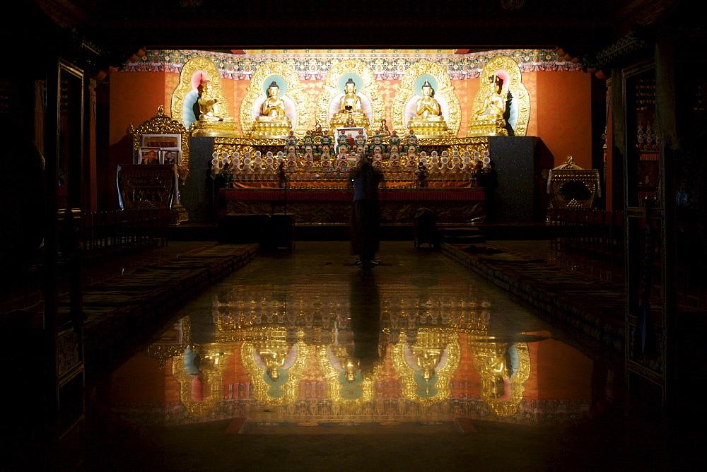 A Buddhist monk prays in a Buddhist monastery near Kathmandu, Nepal