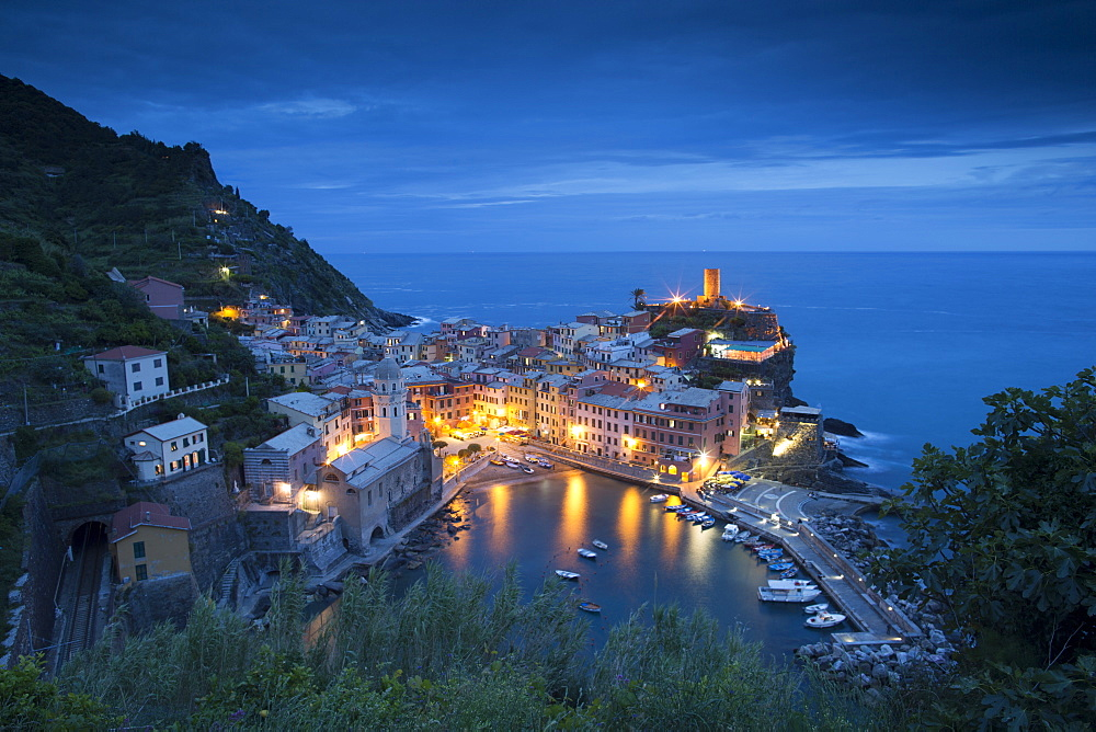 Vernazza in Italy's Cinque Terre shimmers at dusk. - 857-88742
