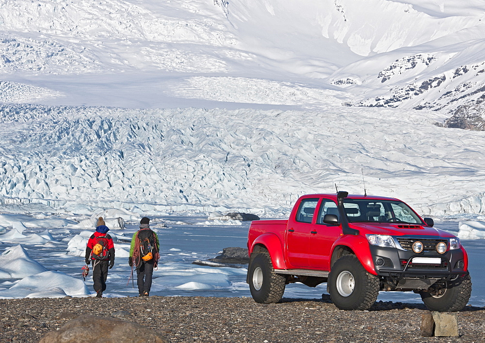 2 climbers hiking of from customised SUV / Icelandic superjeep