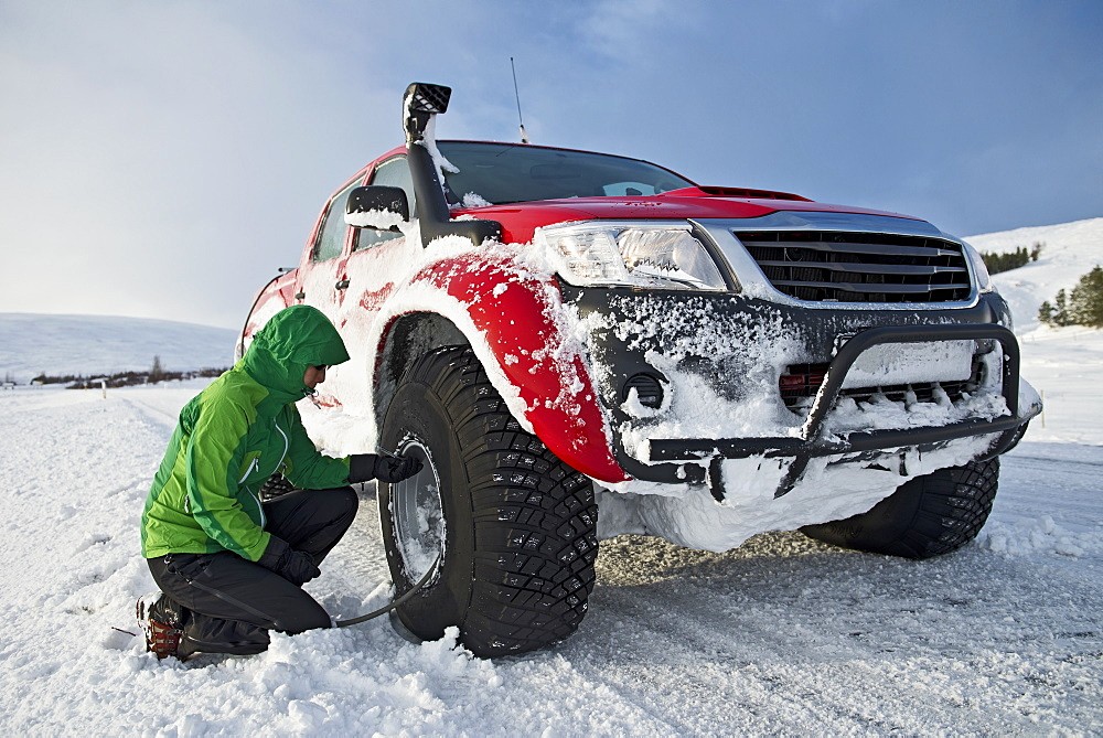 reinflating tyres of a customised 4x4 pick up truck close to Laugar in north Iceland