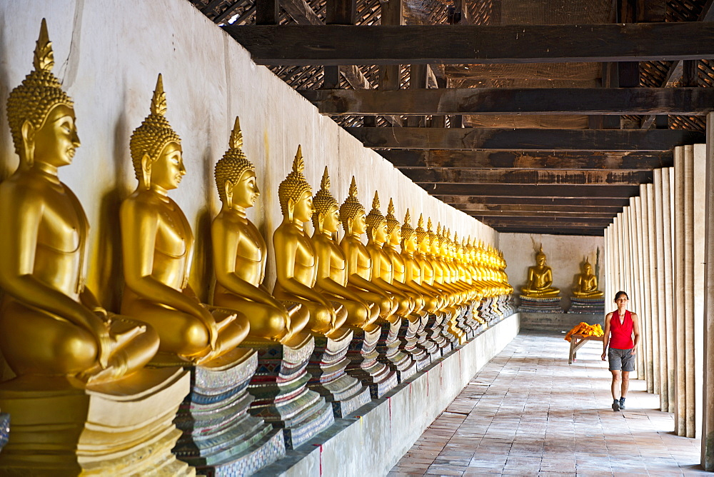 woman exploring the temple of Wat Phutthai Sawsn in Ayutthaya - 857-89037