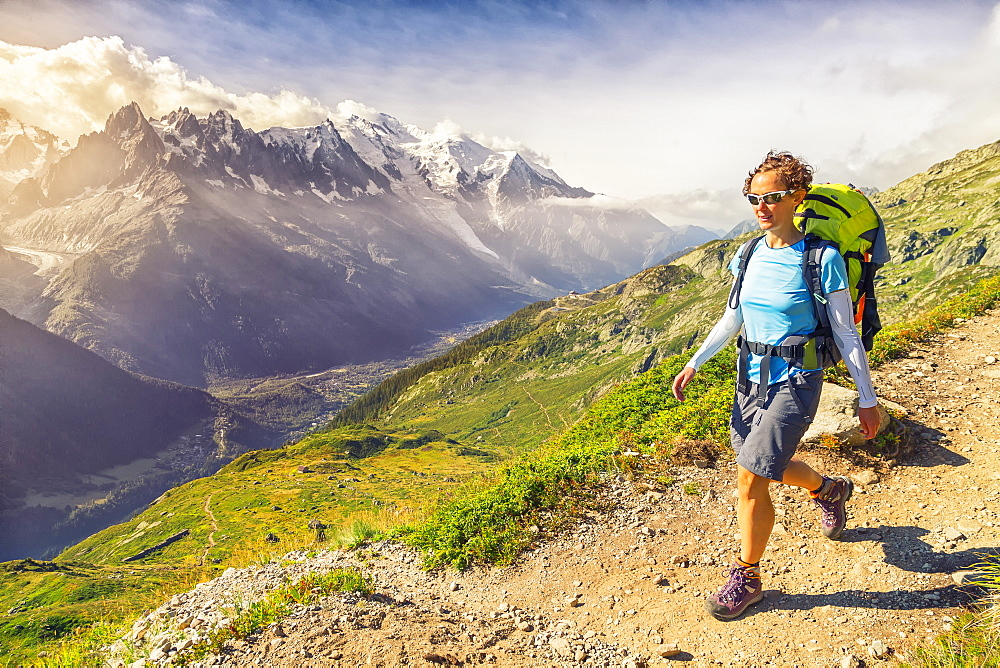 Roberta walks over Chamonix during the Tour of the Mont Blanc