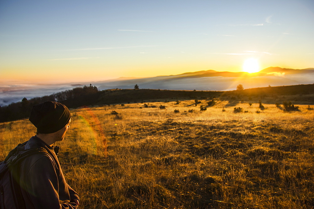 Hiker looking at sunrise