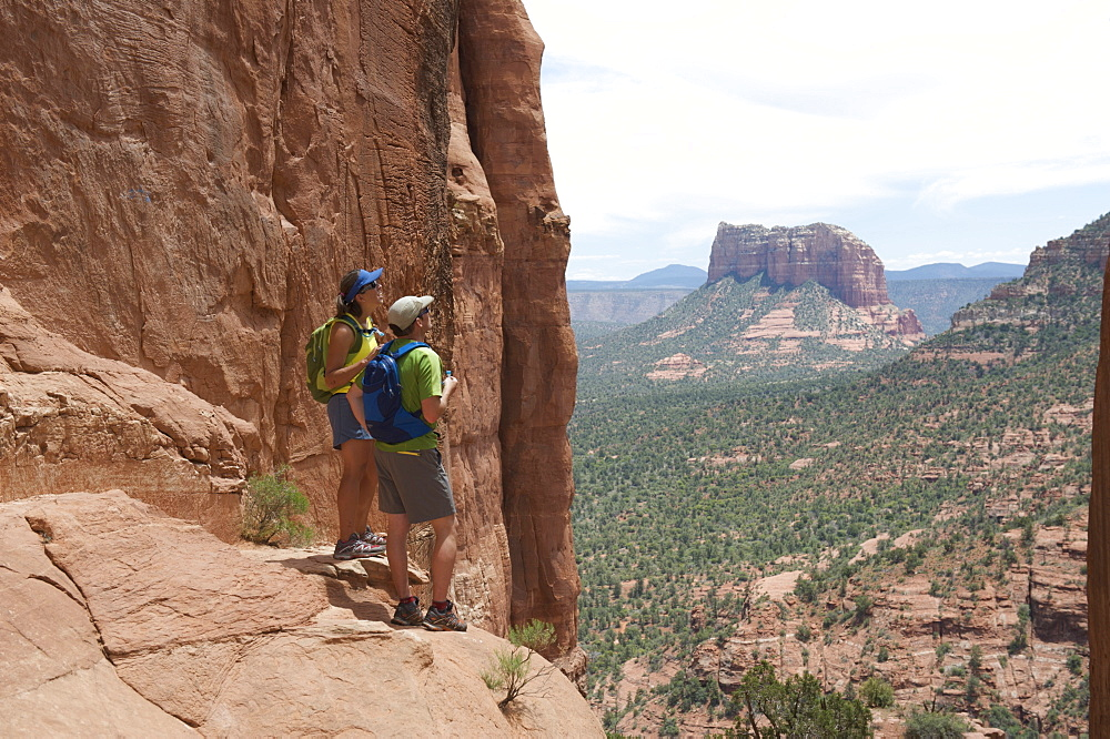 Day hikers at the Cathedral Rock vortex in Sedona, Arizona May 2011.  Easy 1.5-mile hike leads to the saddle between The Mace and The Cathedral giving views to all of Sedona's monuments.