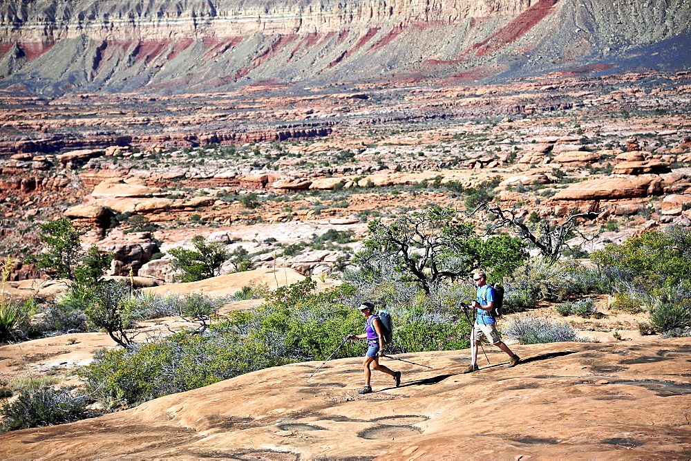 Hikers on the sandstone Esplanade of the Thunder River Trail below the North Rim of the Grand Canyon outside Fredonia, Arizona November 2011. The 21.4-mile loop descends 2000-feet in 2.5-miles through Coconino Sandstone from the Bill Hall trailhead to connect the Thunder River and Deer Creeks trails.  Hikers descend into the lower canyon through a break in the 400-foot-tall Redwall to access Surprise Valley, Deer Creek, Tapeats Creek via Thunder River and even the Colorado River.