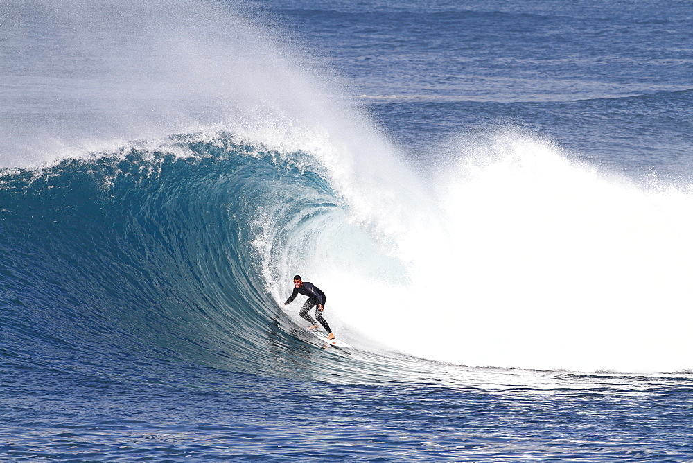 Surfer riding a big hollow perfect wave. Fuerteventura, Canary Islands
